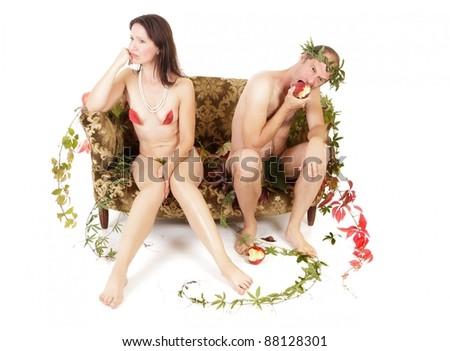 upset naked couple adma and eve like - stock photo
