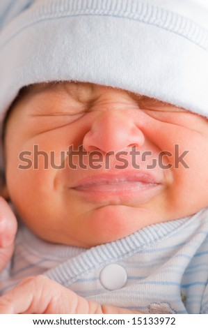 Upset newborn baby cries out of need