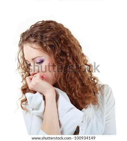 upset pretty woman sad looking down, young girl wear shirt with curly hair, isolated over white background, concept of depression, stress and problems