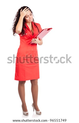 Upset professional young nurse or medical woman  doctor with big breasts, wearing tangerine tango orange uniform dress ,with clipboard.  Full body isolated on white background - stock photo