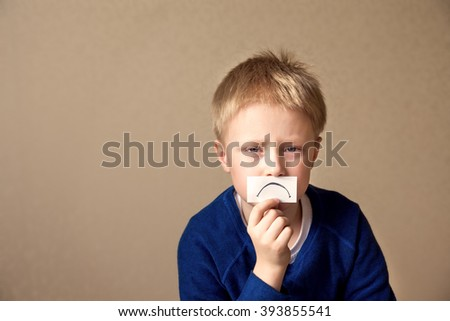 Upset sad young boy (teen) goes to stress, negative mood. Portrait with copy space - stock photo