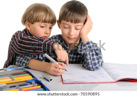 Upset schoolboy doing homework, his brother is helping  him and gives advices. isolated on white - stock photo
