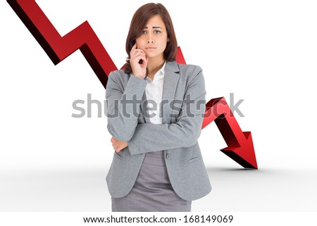 Upset thinking businesswoman against red arrow pointing down - stock photo