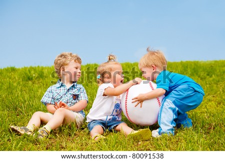 Upset toddlers fighting for the ball - stock photo