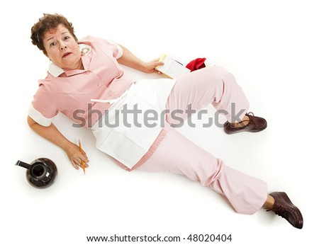 Upset waitress looking up from where she's fallen on the floor. - stock photo