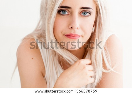 Upset woman disappointed looking at the camera. The concept of divorce, loneliness, misunderstanding,  disapproval. photo on the white background - stock photo
