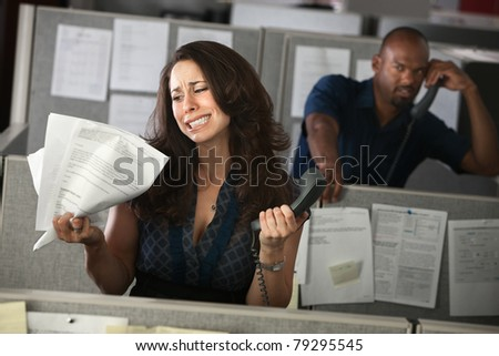 Upset woman office worker holding documents and phone