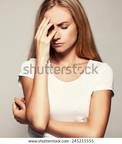 Upset woman. Sad female. Headache - stock photo