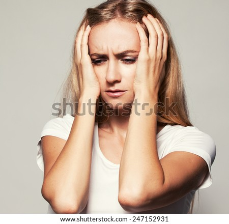 Upset woman. Sad female. Headache. Problems - stock photo