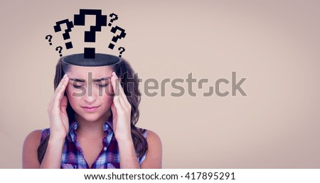 Upset woman suffering from headache against beige background - stock photo