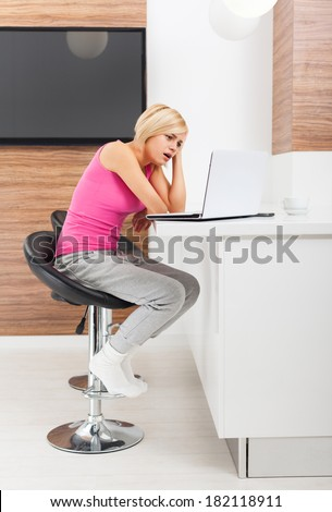 upset woman using laptop at home unhappy negative emotion, sad girl problem surfing on computer