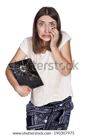 upset young woman with broken tablet