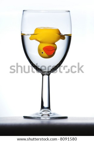 upside down duck in wine glass - stock photo
