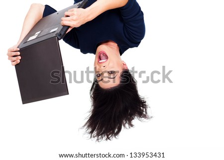 upside down photo of girl using laptop computer - stock photo