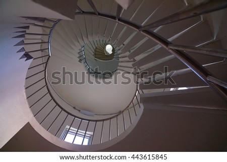 Upside view of a spiral staircase,select focus with shallow depth of field.