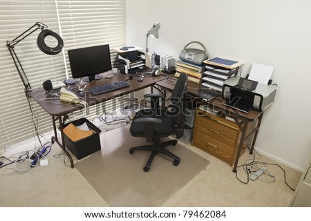 Upstairs home office with chaos of cords. - stock photo