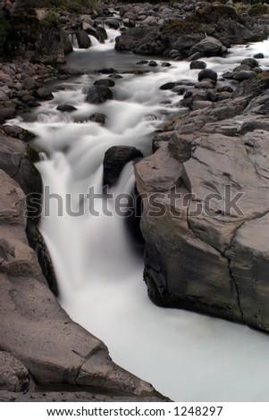 Upstream of waterfall - stock photo