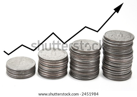 Upward arrow graph over coins - stock photo