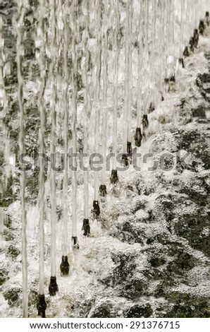 Upward together in a formal garden: Row of spouts with jets of water in long fountain for relaxation and contemplation - stock photo