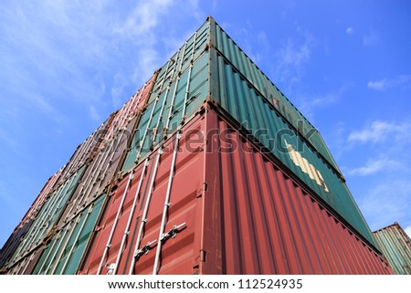 Upward view for stack of Cargo Containers under blue sky at sunrise in an intermodal yard. - stock photo