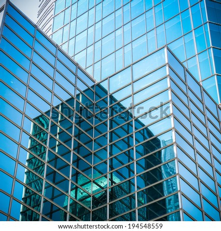 upward view of modern glass skyscraper,exterior of glass wall with abstract texture  - stock photo