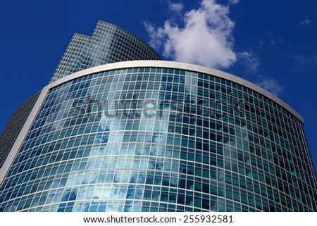 Upwards view of a modern office building. - stock photo