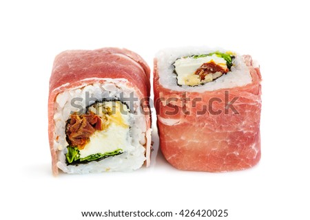 Uramaki maki sushi with procsiutto, two rolls isolated on white