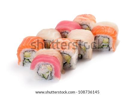 Uramaki. Rainbow. Salmon, tuna, grouper, yellowtail, tiger prawns, crab meat, cucumber and avocado. On a white background. - stock photo