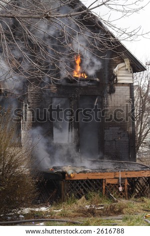 Urban abandoned  Detroit House on fire in the winter - stock photo