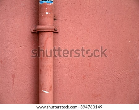 Urban abstract,pink wall an pipeline - stock photo