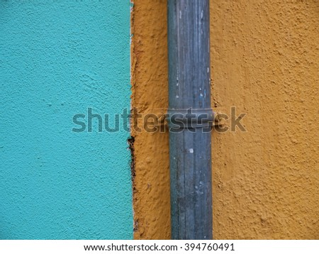 Urban abstract,wall and pipeline - stock photo