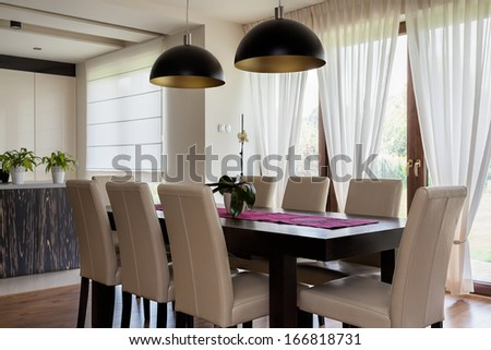 Urban apartment - interior of a dining room, table - stock photo