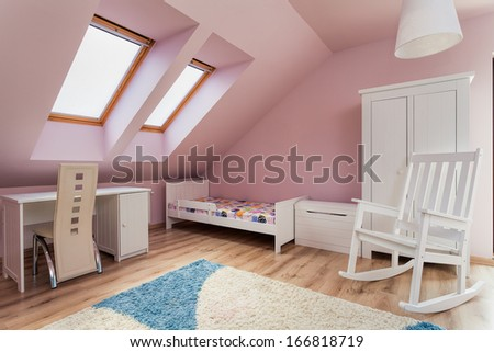 Urban apartment - pink room on the attic - stock photo
