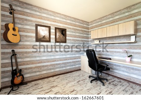 Urban apartment - striped office with two guitars - stock photo