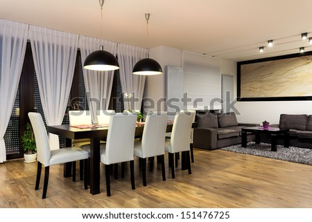 Urban apartment - Table with chairs in modern dining room - stock photo