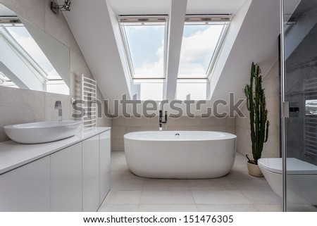 Urban apartment - white bathroom with modern bath - stock photo