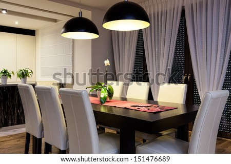 Urban apartment - Wooden table in a dining room - stock photo