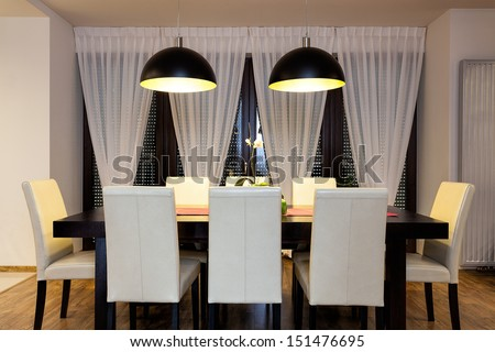 Urban apartment - Wooden table in dining room - stock photo