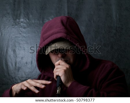 Urban artist, rapper singing - stock photo