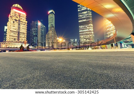 Urban asphalt road and modern architecture at night?Shanghai ,China - stock photo