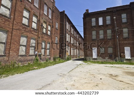 Urban Automotive Blight - Abandoned Automotive Factory - Worn, Broken and Forgotten VII - stock photo