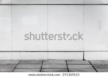 Urban background interior with white metal wall and concrete pavement - stock photo