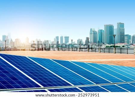Urban background solar panels, Shanghai, China. - stock photo