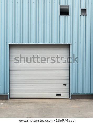 Urban background. Warehouse doors.