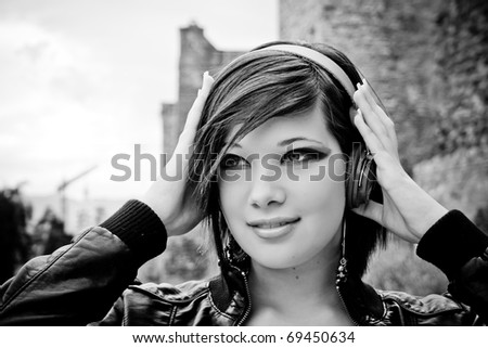 Urban beautiful girl, concentrated in music