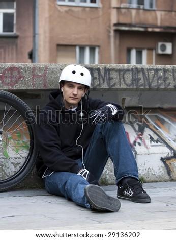 Urban bike rider chilling - stock photo