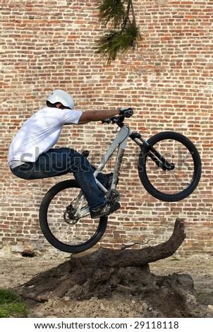 Urban bike rider doing a trick - stock photo