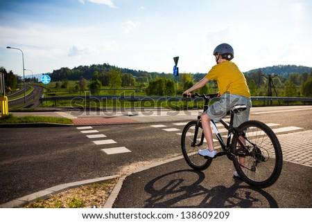 Urban biking - teenage boy and bike in city - stock photo