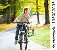 Urban biking - teenage boy and bike in city park  - stock photo