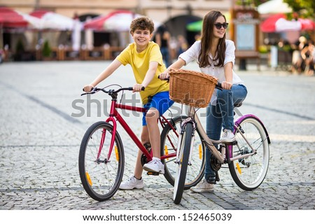 Urban biking - teens and bikes in city  - stock photo